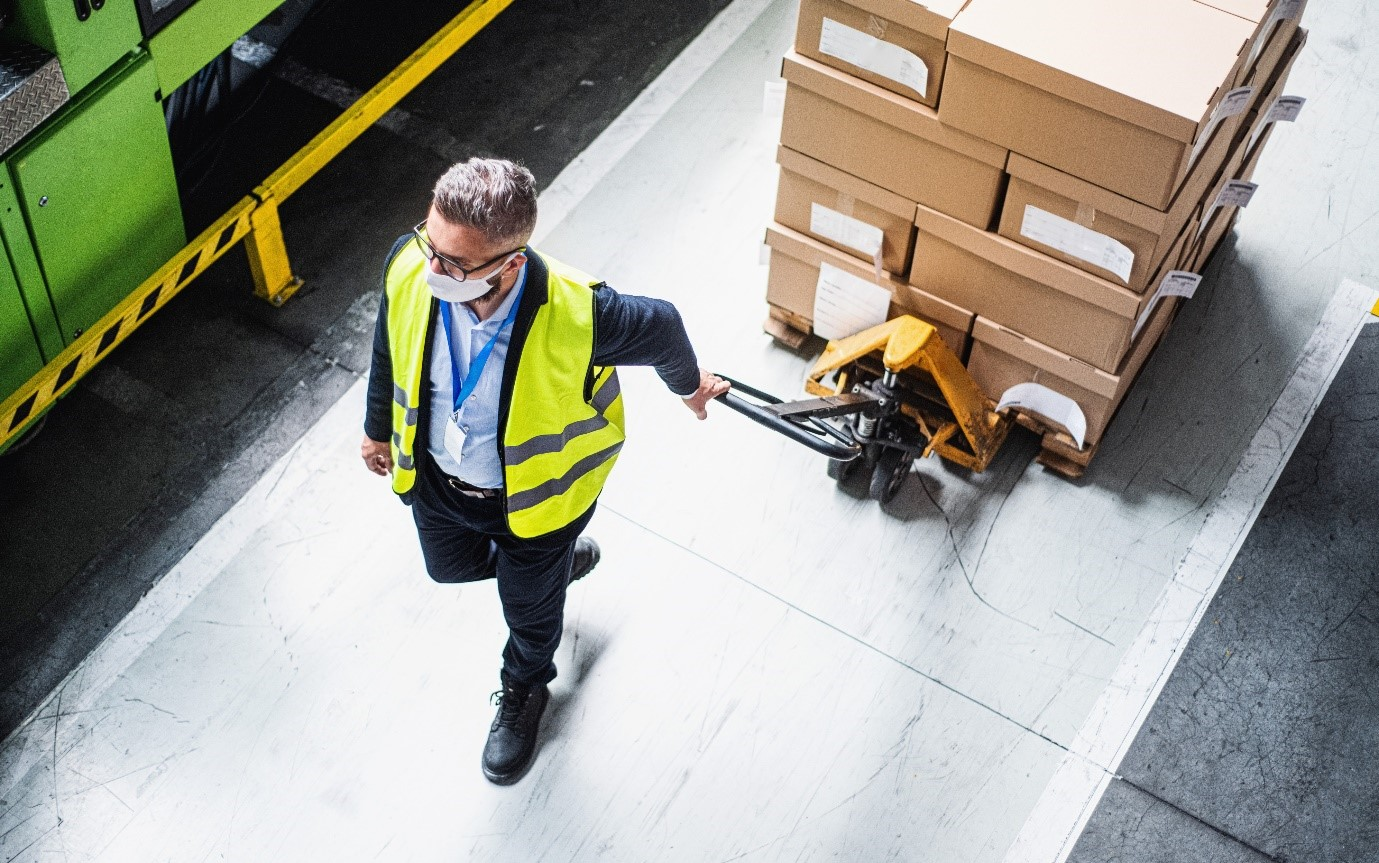 Man Working in Warehouse with a Mask On
