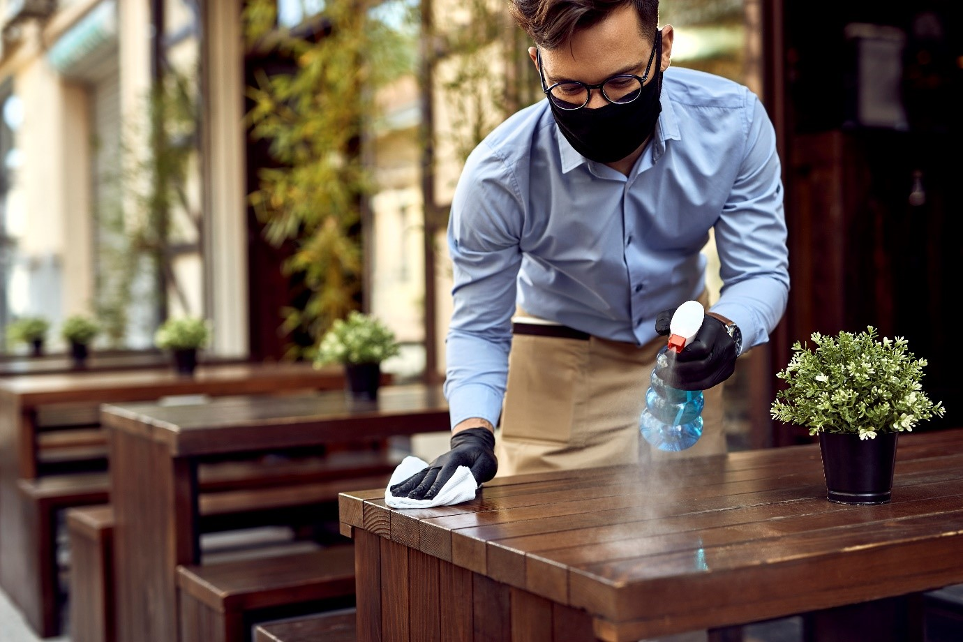 Waiter Cleaning a Table